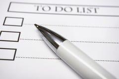 Cierre encima del papel de nota del recordatorio y hacer la lista fotografía de archivo