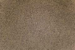 Cierre granoso gris blanco negro de la superficie del asfalto para arriba Textura ?spera imagen de archivo