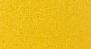 Cierre macro de la piel artificial del modelo de color naranja moderno de la piel encima del fondo texturizado imagen de archivo libre de regalías