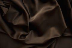 Cierre marrón de la seda del satén del paño para arriba fotos de archivo