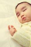 Cierre para arriba de la mano del bebé Foto de archivo