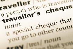 Cierre para arriba de la vieja página inglesa del diccionario con el ' Traveller's cheque ' de la palabra Fotografía de archivo