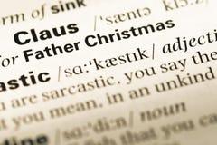 Cierre para arriba de la vieja página inglesa del diccionario con la Navidad del padre de la palabra Imagen de archivo libre de regalías