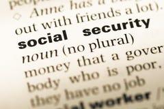 Cierre para arriba de la vieja página inglesa del diccionario con Seguridad Social de la palabra Imágenes de archivo libres de regalías