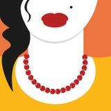 Cierre plano del diseño encima de la mujer con el collar rojo Foto de archivo libre de regalías