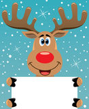 Ciervos de Rudolph que sostienen el papel en blanco para su texto Imagen de archivo