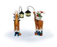 Ciervos del montar a caballo de los pares del muñeco de nieve del Año Nuevo Imágenes de archivo libres de regalías