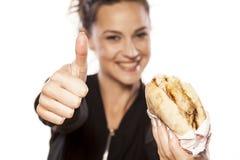 Cieszyć się fast food Zdjęcie Stock