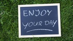 Cieszy się twój dzień pisać obraz stock