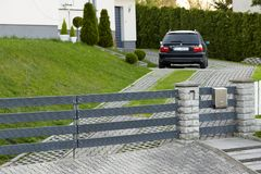 Cieszyn, Poland - 15 April 2018: The car is parked in a private parking lot behind the rolling gate. royalty free stock images
