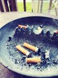 Cig. Butt, gross, smoking, arette royalty free stock photos