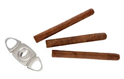 Cigar. Guillotine cigar and cigar on a white background Royalty Free Stock Images
