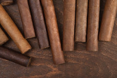 Cigar. S on a dark background close up Stock Images