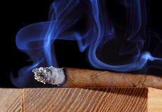 Cigar with abstract smoke Royalty Free Stock Photo