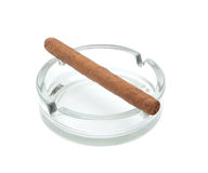 Cigar in an ashtray. Isolated object Royalty Free Stock Image