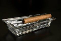 Cigar at ashtray Stock Photography
