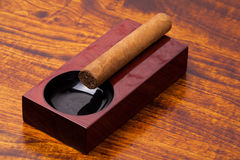 Cigar on ashtray Royalty Free Stock Images