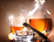 Cigar on ashtray Stock Photography