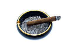 Cigar and ashtray Stock Photo