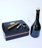 Cigar Box with Cuban Cigar and Cigar Equipment with Bottle of Re. Cigar in Cigar Boxr and Cigar Equipment with Bottle of Red Vine and Vine Cup Isolated on White Royalty Free Stock Photography