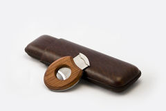 Cigar case with cigar cutter. Isolated in white background Stock Photos