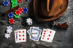 Cigar, chips for gamblings, drink and playing cards Royalty Free Stock Photos
