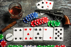 Cigar, chips for gamblings, drink and playing cards Stock Photography