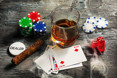 Cigar, chips for gamblings, drink and playing cards Stock Photo