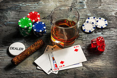 Cigar, chips for gamblings, drink and playing cards Royalty Free Stock Images