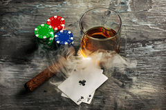 Cigar, chips for gamblings, drink and playing cards Royalty Free Stock Photo