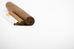 Cigar and cigarettes. On white background Royalty Free Stock Photo