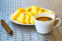 Cigar coffee with lemon and kiwi slices and pineapple. The cigar coffee with lemon and kiwi slices and pineapple stock photography