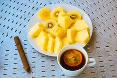 Cigar coffee with lemon and kiwi slices and pineapple. The cigar coffee with lemon and kiwi slices and pineapple royalty free stock images