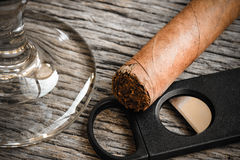 Cigar and Cutter with Glass of Brandy or Whiskey Royalty Free Stock Photos
