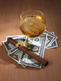 Cigar and dollar Royalty Free Stock Photography