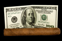 Cigar and Dollars Royalty Free Stock Photography