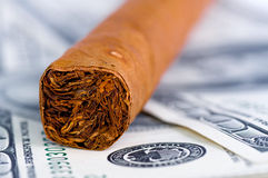 Cigar and Dollars Stock Photography