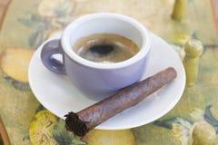 Cigar and espresso coffee. Cigar and italian espresso coffee royalty free stock photo