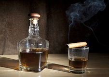 Cigar and glass whiskey Stock Photos