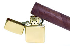 Cigar and golden lighter. Stock Images