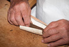 Cigar makers hands stock photo