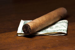 Cigar. And money on a table royalty free stock images