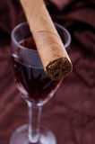 Cigar On The Glass With Alcohol Stock Photos