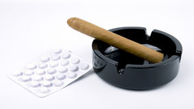 Cigar and pills Royalty Free Stock Photos