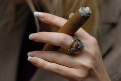 Cigar and ring. Royalty Free Stock Images