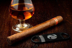 Cigar and rum. Cuban cigar with a glass o rum royalty free stock photos