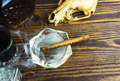 Cigar, smoke, alcohol and skull Stock Images