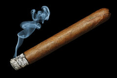 Cigar. With smoke isolated on black background stock photography