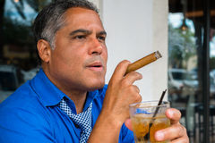 Cigar smoker Stock Images