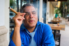 Cigar smoker Stock Image